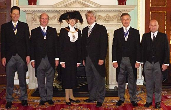 Master Simon Bartley and the Wardens with Lord Mayor Fiona Woolf sporting her new hat