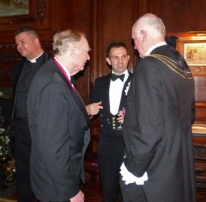 Past Master Anthony Phillips, Commander Peter Laughton and Sheriff Adrian Waddingham enjoy a stirrup cup