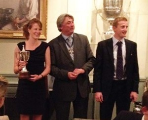 Winners Rob and Claire Hunt receive their trophy from the Master