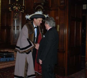 Master Peter Simeons receives Past Master Nick Heal