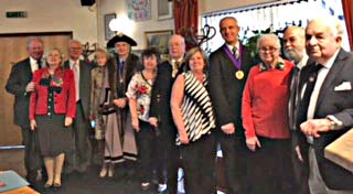 Pensioner hatters join the Master at the St. Clement's day lunch on 23 November 2016.